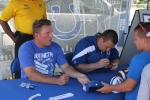 Pat McAfee & Joe Reitz signing autographs for a young Colts fan