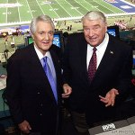 Pat Summerall and John Madden in the broadcast booth.