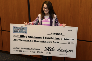 Layla Viles, a one-time patient of Riley Hospital accepts the check.