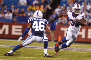 Buffalo Bills' James Wilder Jr. (38) eludes Indianapolis Colts cornerback Frankie Williams (46) during the second half of a preseason NFL football game Saturday, Aug. 13, 2016, in Orchard Park, N.Y. (AP Photo/Adrian Kraus)